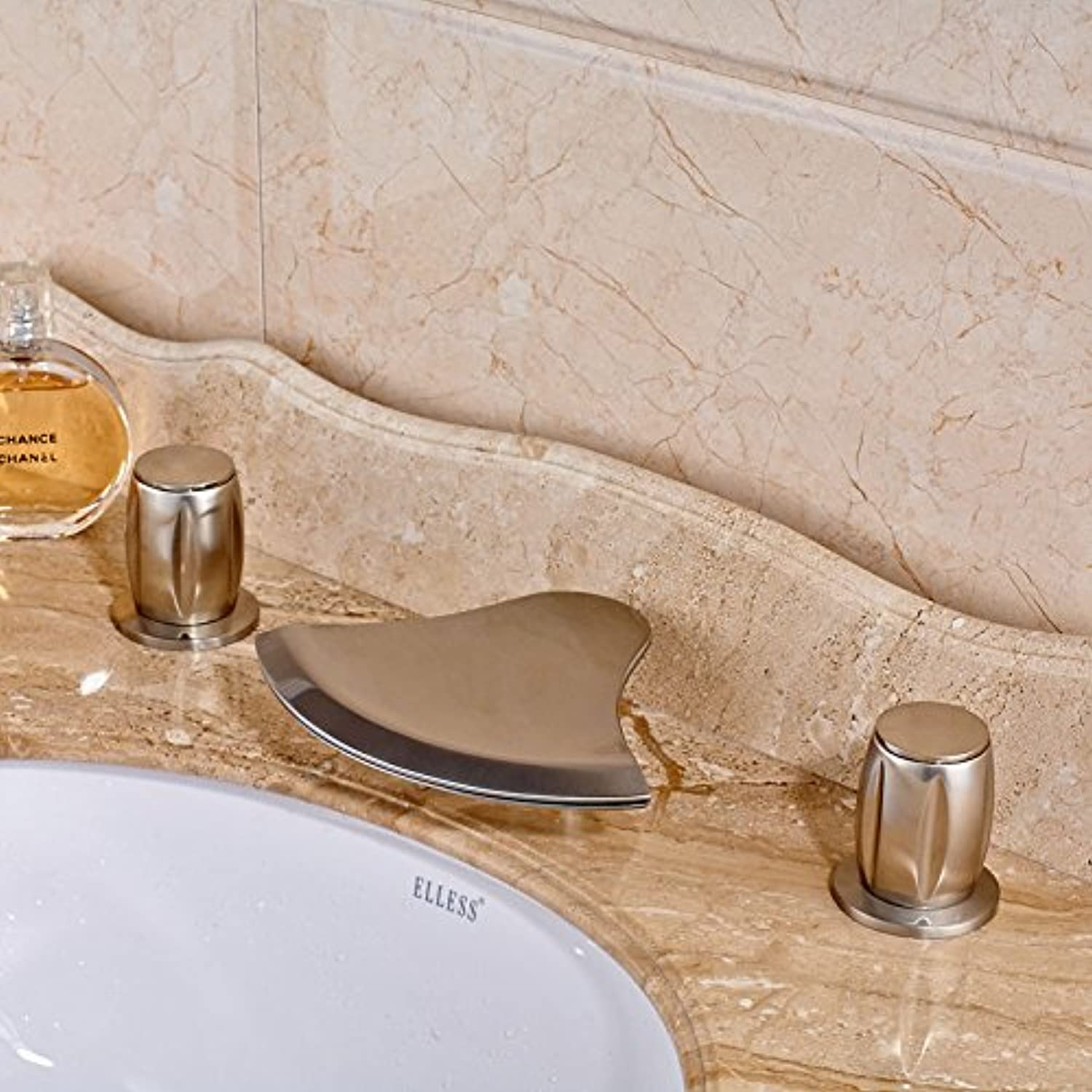 Maifeini The Bathroom Has A Polished Nickel Basin Mixer With Dual Three Holes In The Mounting Of The Deck