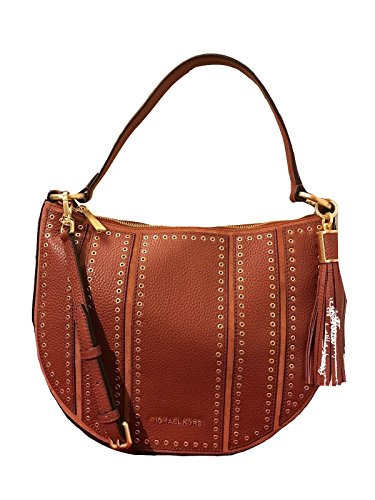 """Grommets and a long leather tassel decorate this handbag Top zip closure shoulder bag Hanging Leather Tassel on the side Inside: 1 zippered pocket & 4 multi-function slip pockets L: 13"""" x H: 10"""" x W: 3.5"""""""