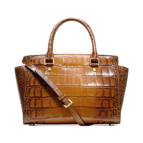 Gorgeous texture leather with polished brass hardware Measures approx. 12 inch (W) x 10 inch (H) x 6.5 inch (D) Zipper top closure; fully lined interior with large zipper pockets & multifunction slip pockets Two leather handles with 4 inch drop; MK s...