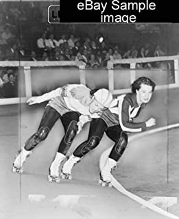 1950 TITLE: Swinging down the track. Two women compete in roller derby world e2