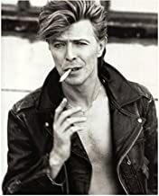 David Bowie Dressed in Leather Jacket Smoking with Exposed Chest and Thick Full Hair Black and White 8 x 10 Inch Photo