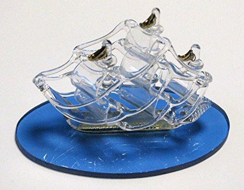 Idea bomboniere: veliero in vetro con base blu trasparente e particolari in oro cm 10*8; scatola vetrina con spugna