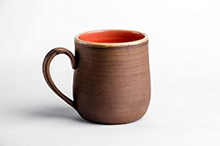 red pottery mugs