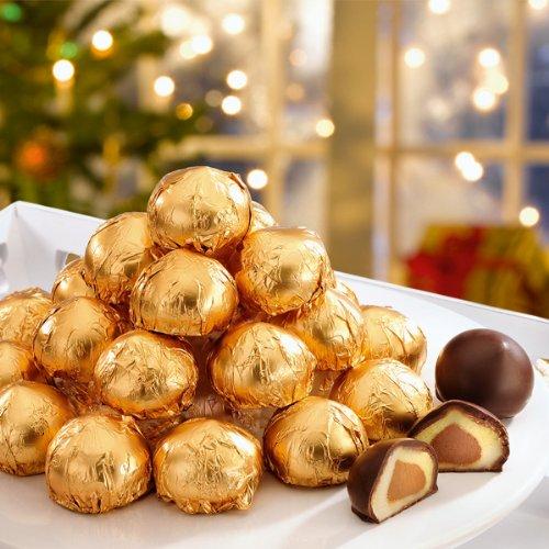 Mozartkugeln (400g) Schokoladen-Praliné in Geschenkverpackung mit Schleife. Diese Mozartkugeln haben ein Herz aus feinem Nougat, das von Marzipan umgeben ist. €24,88/kg