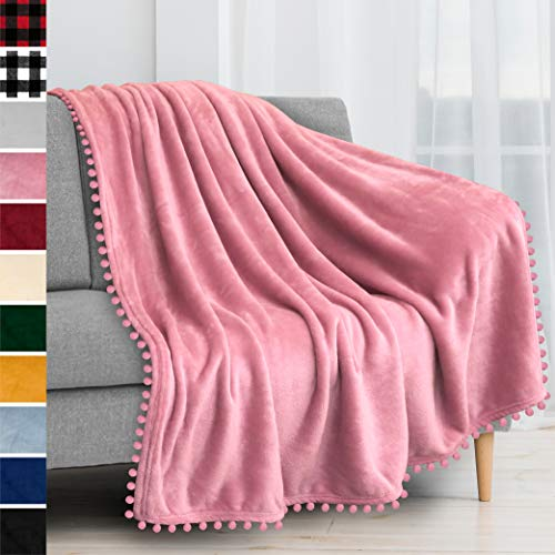 PAVILIA Fleece Throw Blanket with Pom Pom Fringe | Blush Pink Flannel Throw | Super Soft Lightweight Microfiber Polyester | Plush Fuzzy Cozy Blossom Pink | 50 x 60 Inches