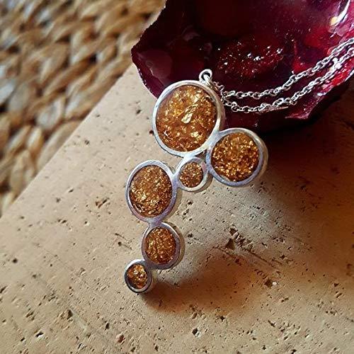 Wunderschöner Anhänger in Silber mit zarten Goldplatten im Harz. Exklusiver Design-Anhänger. Wunderschöne Halskette!