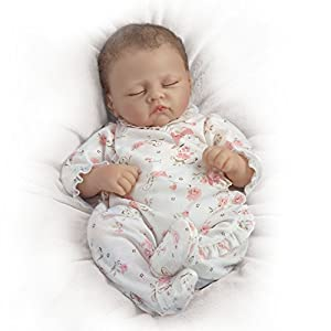 So Truly Real lifelike baby doll by Master Artist Linda Murray that breathes, coos and has a heartbeat Fully poseable and realistically weighted, with RealTouch skin Arrives in a sleeper adorned with roses