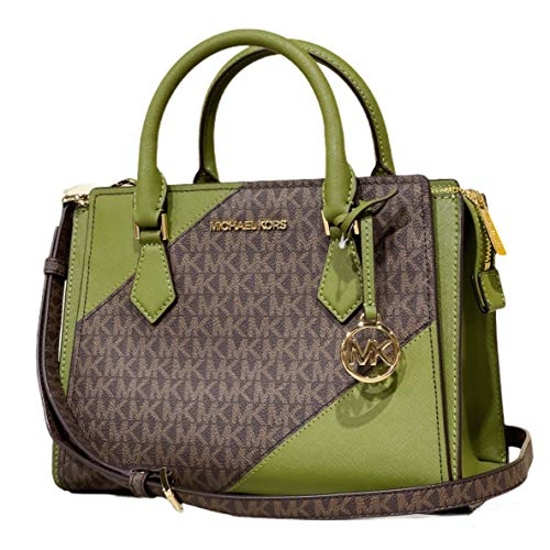 """MK logo print canvas with leather trim 2 open compartments with double magnetic snap button closure Zip compartment in the middle, detachable and adjustable longer strap Interior one zippered and one open slip pocket Approximate measurements: 10.25"""" ..."""