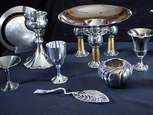 Spear Guns, Wood and Tile Cabinets, and Pewter Goblets