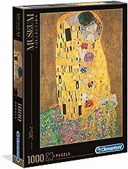 Clementoni- Museum Collection-Klimt: Il Bacio Los Pingüinos De Madagascar Puzzle, 1000 Piezas, Multicolor, 12+ (31442)