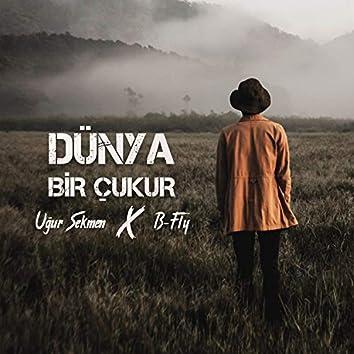 Dünya Bir Çukur (feat. Uğur Sekmen)