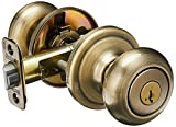 Kwikset Juno Keyed Entry Door Knob with Microban Antimicrobial Protection featuring SmartKey Security in Antique Brass