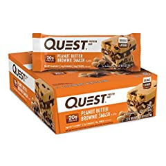 YOU DESERVE A SPECIAL TREAT: The Quest Peanut Butter Brownie Smash Protein Bars taste like your favorite treat to make around the campfire. Only our version has 20g protein, 6g net carbs and 2g of sugar per bar UNWRAP COMPLETE PROTEINS: The Quest Pea...