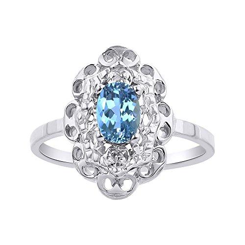 Juego de anillos de topacio azul y diamante en oro blanco de 14 quilates con halo de diamante
