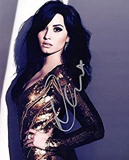 Demi Lovato Signed - Autographed Sexy Singer - Actress 8x10 inch Photo - Guaranteed to pass BAS - Beckett Authentication