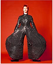 David Bowie Dressed in Black and White Striped Suit with Mega Circular Bell Bottoms Red Background 8 x 10 Inch Photo