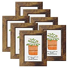 Made of composite wood and real glass, this picture frame gives your photo in a clear view. The wooden frame size for outline is about 14.2x19.2cm (5.59x7.55 inch), ideal home decoration for 4x6 photo or print. 7 PCS per set, this rustic picture fram...