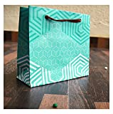 INFORMATIVE GIFT WRAPPING STYLE INTELLECTUAL USE OF PAPER IN GIFTING WORLD ATTRACTIVE DESIGNS FOR YOUR SPECIAL REASONS A PAPER BAG, A LITTLE MORE THAN A BAG AND A GIFT JUST FOR EVERY REASON AND SEASON