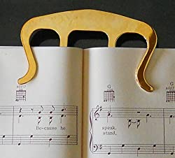 Golden finish premium book music clip or page holder for holding book open with one hand.