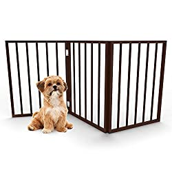 puppy sitting beside a freestanding dog gate