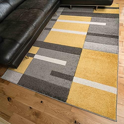 Alfombra amarilla y gris con diseño de Pachtwork