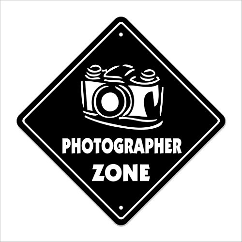 Sign on the door photographer zone for Door zone llc