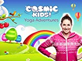Woman standing in front of a rainbow for Yoga Adventures. Action songs for kids