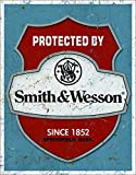 Desperate Enterprises Protected by Smith & Wesson Tin Sign, 12.5' W x 16' H