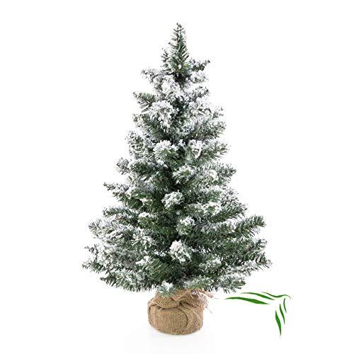 artplants.de Künstlicher Mini Weihnachtsbaum Reykjavik im braunen Dekosack, beschneit, 75 Zweige, 60cm, Ø 25cm - Kunst Tannenbaum - Deko Christbaum