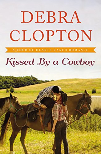 Kissed by a Cowboy (A Four of Hearts Ranch Romance Book 3) (English Edition)