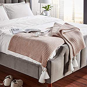 "Imported Give your living spaces a sense of charm with this tassel knit, yarn-dyed throw blanket. The alternating white and natural-colored lines and oversized tassels on each corner make this throw the perfect decoration for a couch or bed. 80""L x 6..."