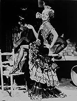 Marlene Dietrich standing One Leg in Floral Gown with One Leg Stepping on Chair Photo Print  8 x 10