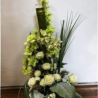 Home design - composizione fiori finti con vaso in ceramica e canne bambù