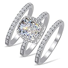 This is an eye-catching 2 carats ( 7x8mm ) cushion cut simulated diamond ring and two bands set. We had achieved a spectacular 101 facets for our cushion cut, which is equivalent to a top grade real cushion cut diamond. Hence, this ring set looks lik...
