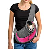 woman holding small pet in a pink and gray dog carrier sling