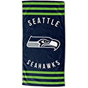 "Features NFL team logo and name in the center of the towel, laid out vertically with bold stripes above and below Soft; lightweight; great for pool or beach Measures 30""W x 60"" L Machine wash cold separately using delicate cycle and mild detergent. D..."