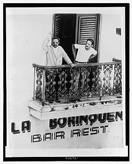 Photo: Pedro Albizu Campos, 1891-1965, on balcony with bodyguard . Size: 8x10 (approximately)