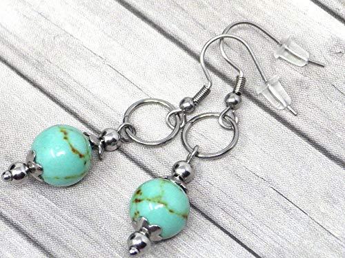 Pendientes de mujer en acero inoxidable con anillos y perlas turquesas reconstituidas azules