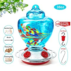 &#9989 COLORFUL AND ATTRACT MORE HUMMINGBIRDS: The unique and shiny colors make the hummingbird feeder more attractive for hummingbirds. 4 flower feeding ports for hummingbird to drink, a nice round perch for the hummingbird to rest on &#9989 EXQUISI...