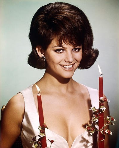 Claudia Cardinale 16x20 Poster in low cut dress holding candles