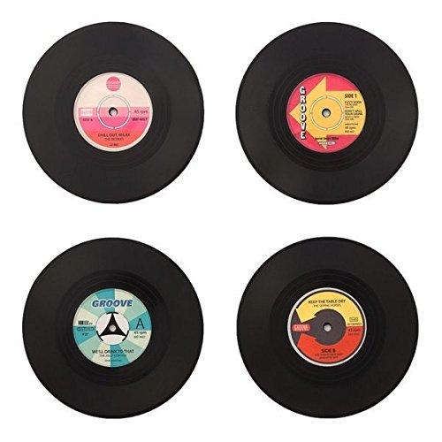 Set 4 Posavasos vinilo originales. Ideales para tu casa.Originales y divertidos. Estos vinillos decorativos son ideales para disfrutar de los tuyos escuchando buena musica sin perder el estilo retro