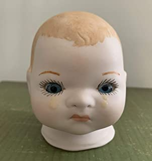 3 faced porcelain baby doll