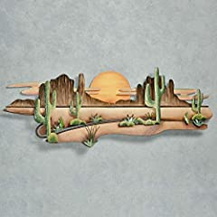 Just as the sun begins to slip beyond the rugged horizon, a majestic feeling of Desert Serenity blankets the barren sands, bold cacti, and silhouetted mesa formations. Relish this same wild bliss in your home with this metal wall sculpture designed b...