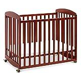 Davinci Alpha Mini Rocking Crib in Rich Cherry | Removable Wheels | Greenguard Gold Certified