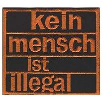 Kein Mensch ist illegal Aufnäher, Schrift orange auf schwarzem Grund