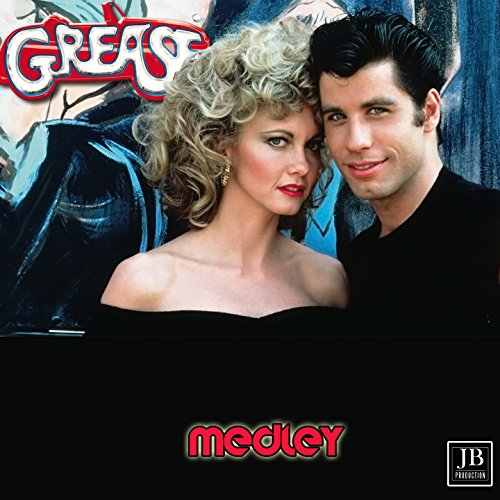 Grease Medley: Grease / Summer Nights / Hopelessly Devoted to You / You're the One That I Want / Sandy / Beauty School Dropout / Look at Me, I'm Sandra Dee / Greased Lightning / It's Raining on Prom Night / Alona at the Drive-In-Movie / Blue Moon