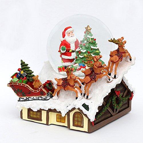 Dekohelden24 Schneekugel mit Santa und Rentierschlitten auf Haus, mit Schneewirbel, Licht und Sound, L/B/H 20,5 x 20 x 23 cm Kugel Ø 13,5 cm.