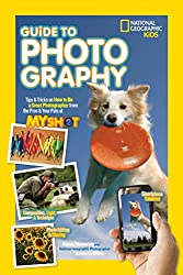 Book cover showing a dog holding a frisbee as the main image with a hand holding a camera phone in the bottom right of the image.