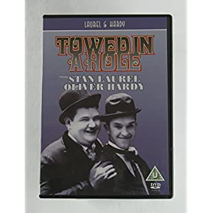 Laurel & Hardy Towed In A Hole