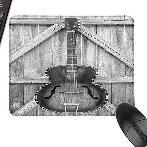 Western Vintage akoestisch instrument gitaar opgehangen op oude houten deur hekken Country Ranch roze muismat